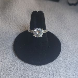 Silver plated beveled round cubic zirconia ring